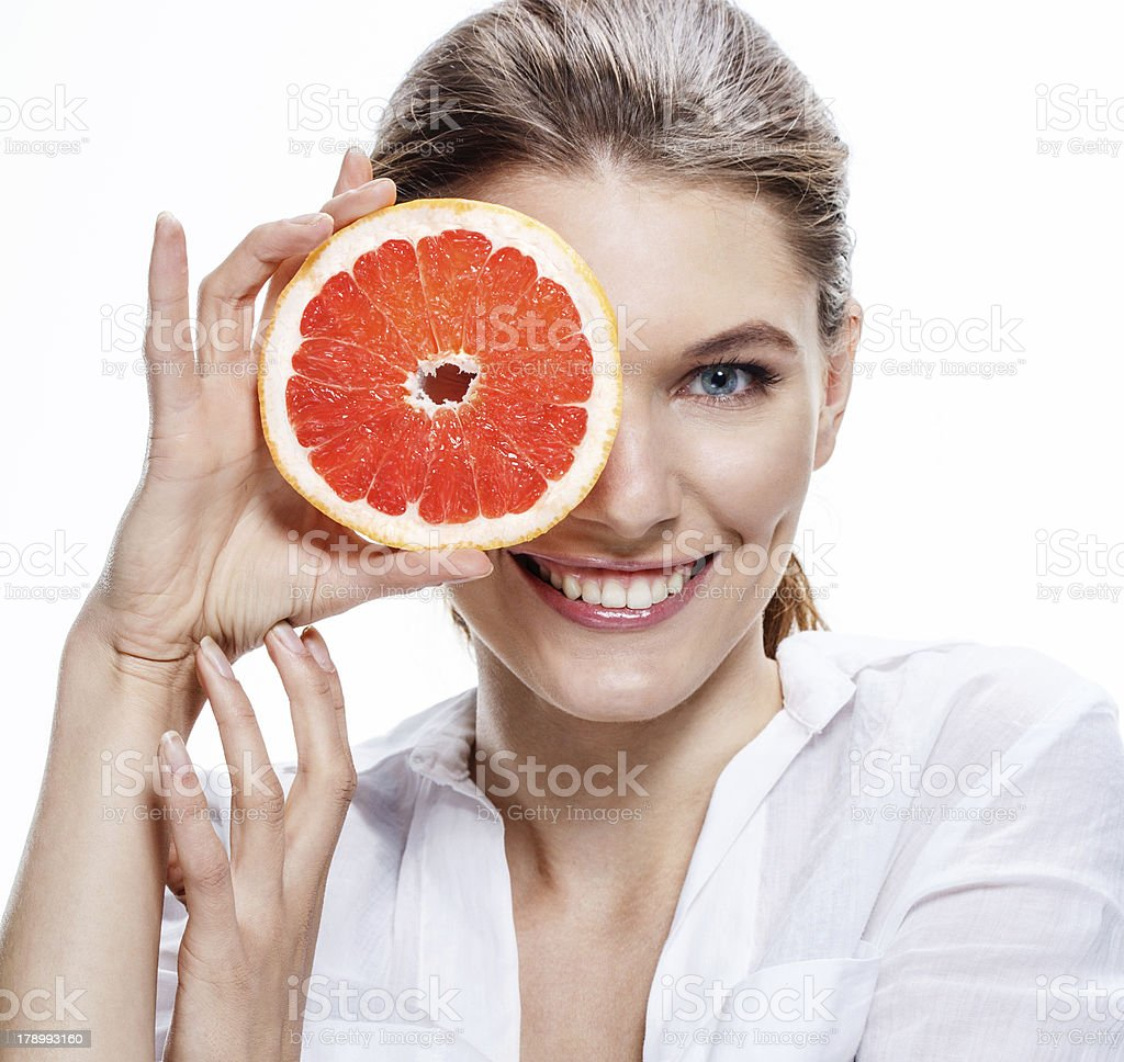 smiling brunette european woman with mottled orange slice royalty-free stock photo