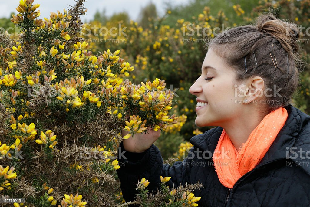 Smiling Russian outdoor girl by gorse on Mitcham Common stock photo
