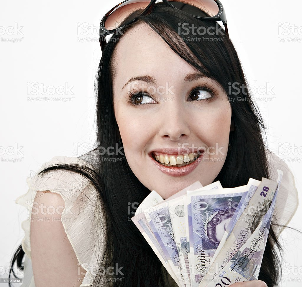 Smiling brunette young woman with handful of Canadian cash royalty-free stock photo