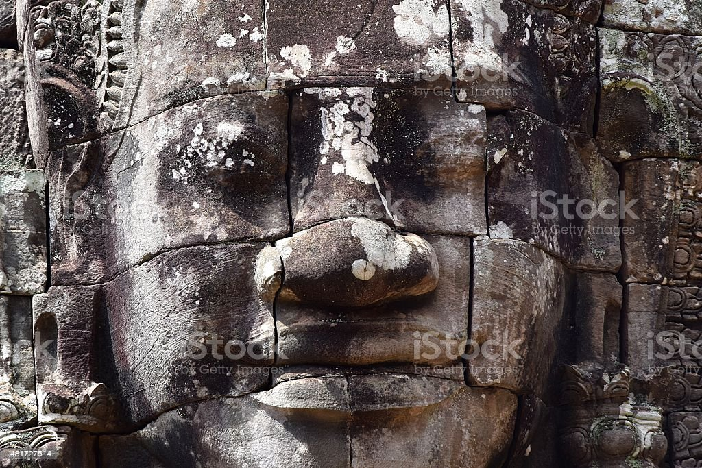 Smiling Buddha Carving at Angkor stock photo