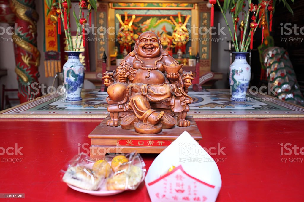 Smiling Buddha - Chinese God of Happiness, Wealth and Lucky stock photo