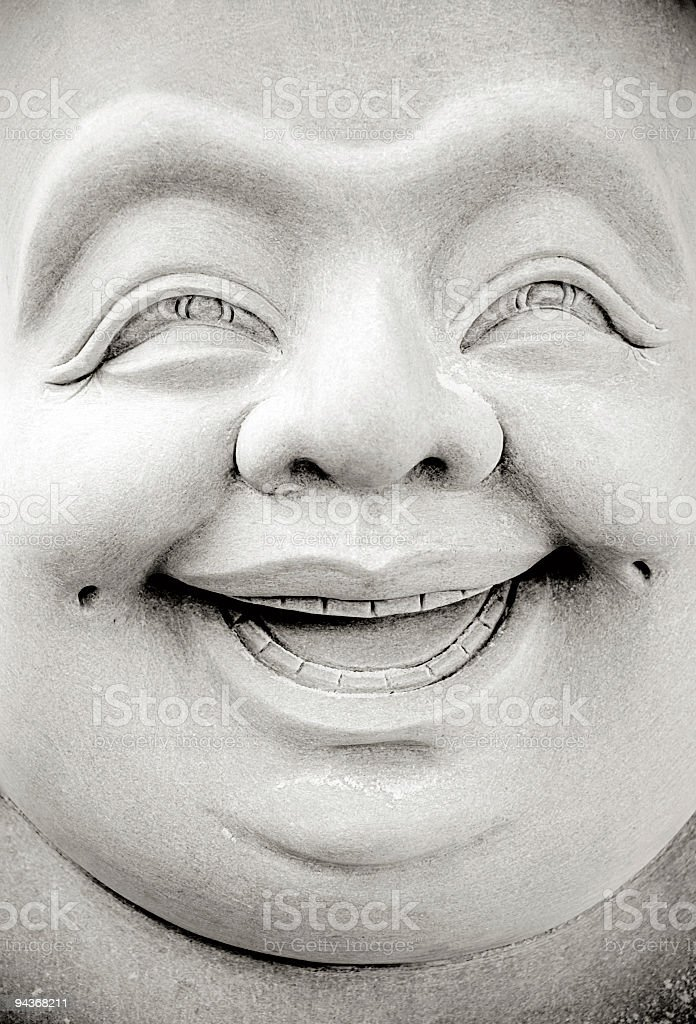 Smiling Buddha stock photo