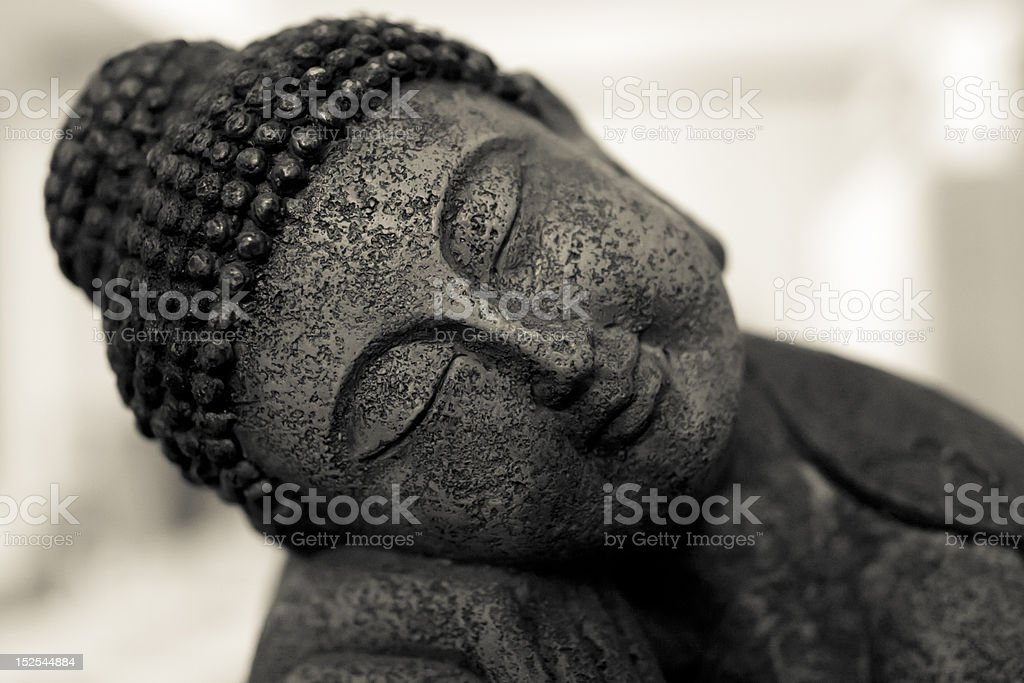 Smiling Buddha resting stock photo