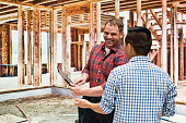 Smiling building contractor discussion with client