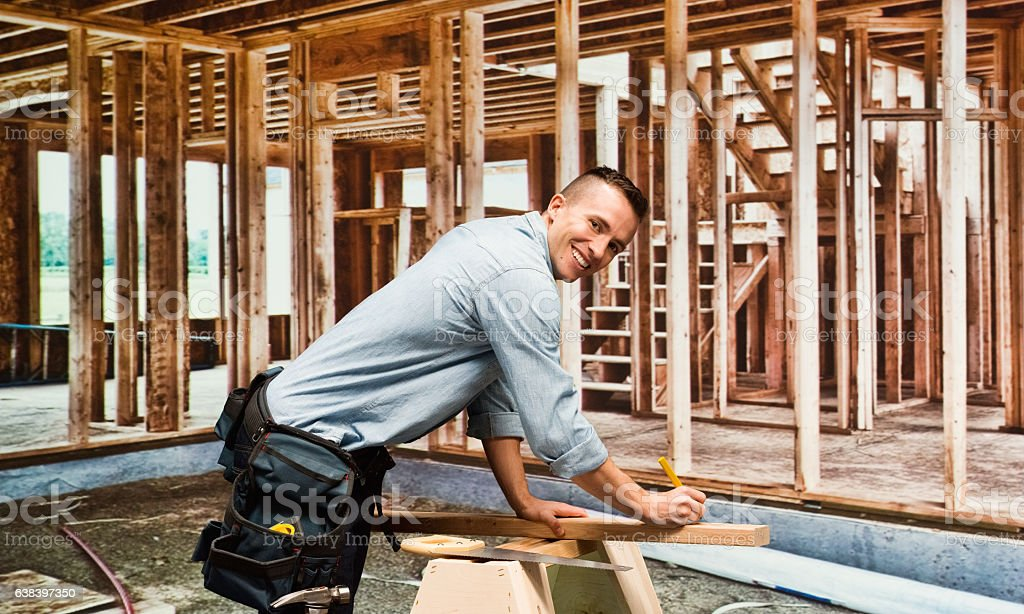 Smiling building contractor in construction site