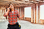 Smiling building contractor on phone