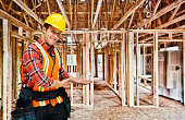 Smiling building contractor presenting