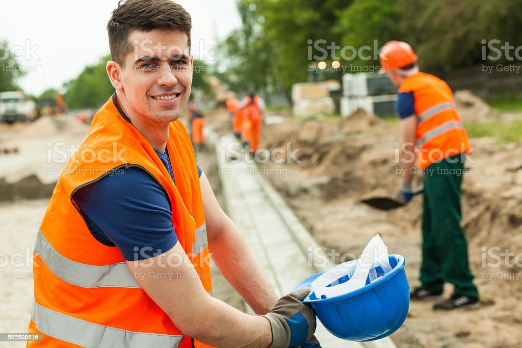 Smiling building worker stock photo