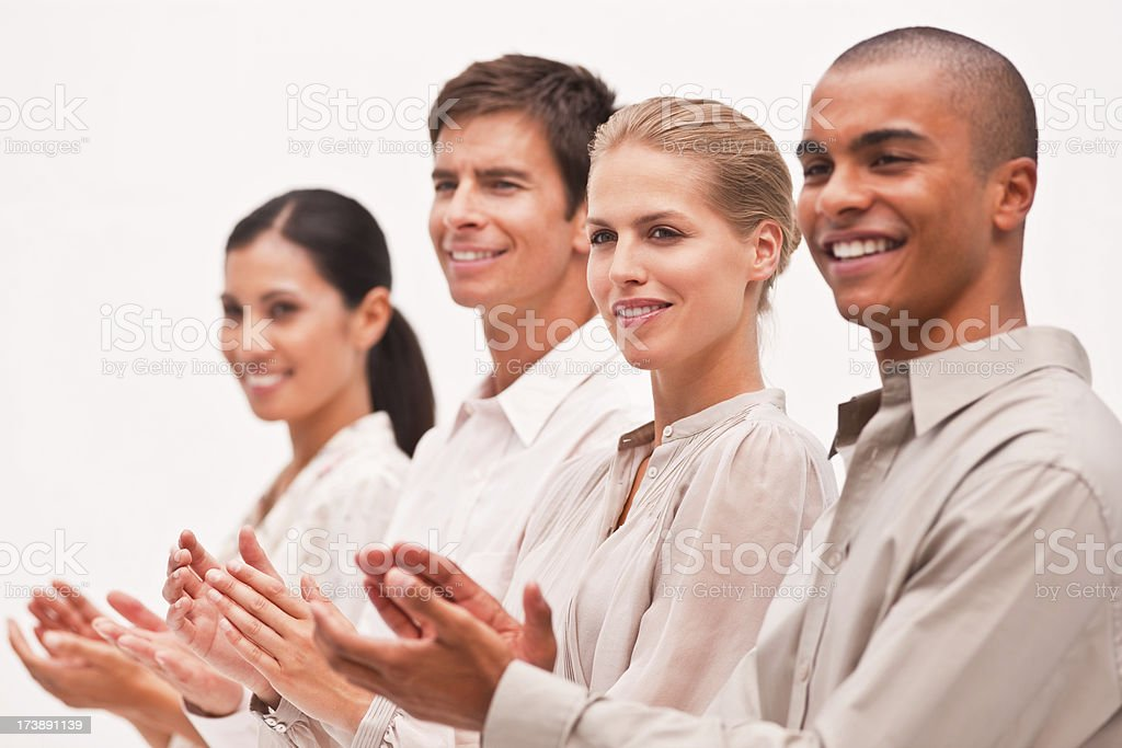 Smiling business colleagues clapping hands royalty-free stock photo