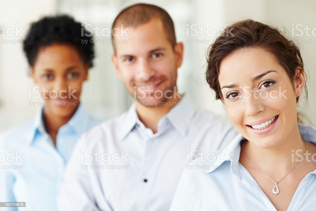 Smiling business colleagues standing angled of each other royalty-free stock photo