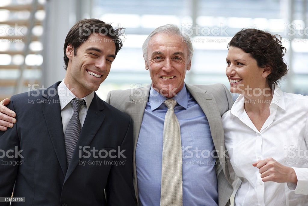 Smiling business colleagues standing together in office royalty-free stock photo