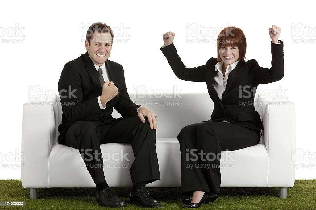 Smiling business couple celebrating their success royalty-free stock photo