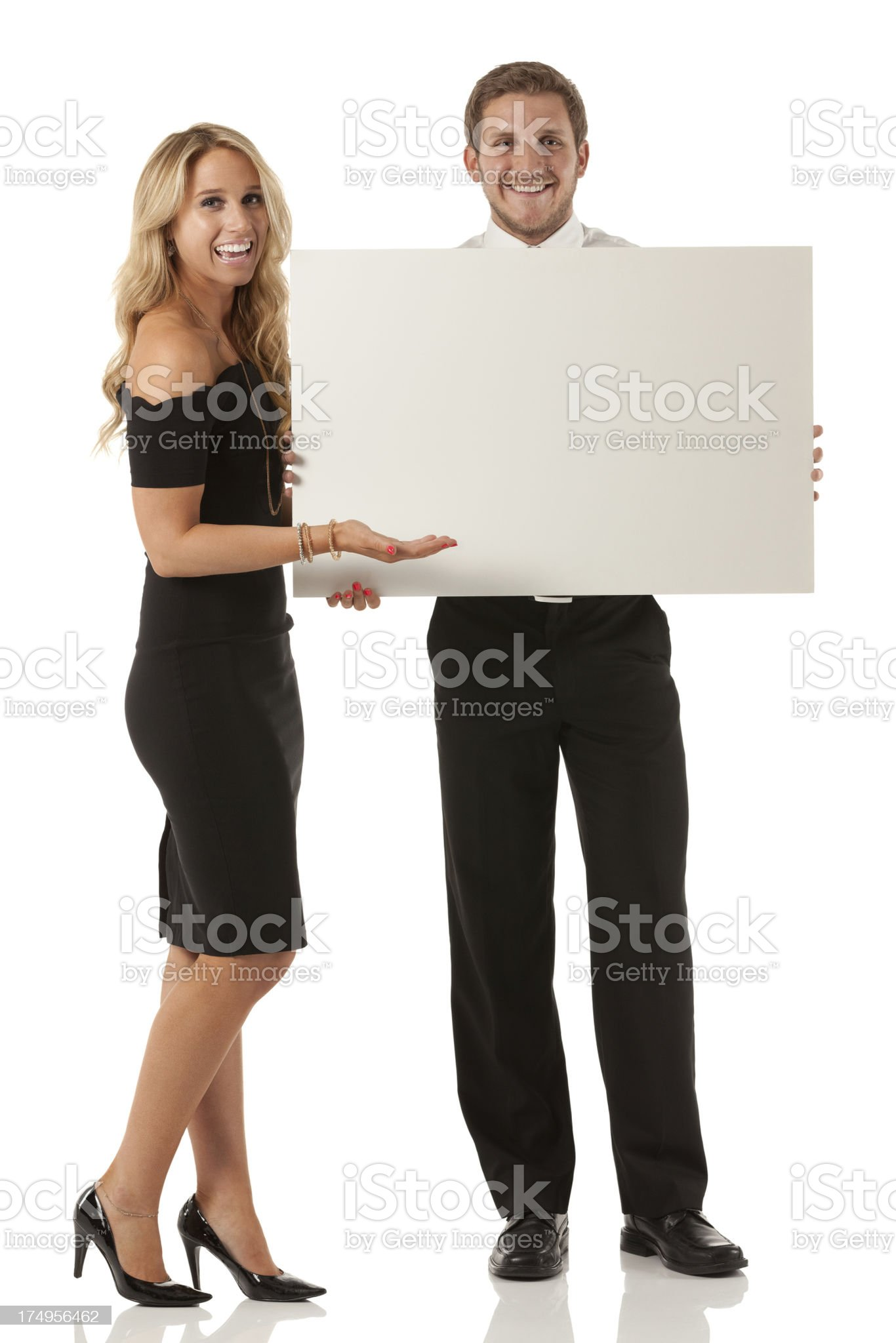 Smiling business couple with a whiteboard royalty-free stock photo