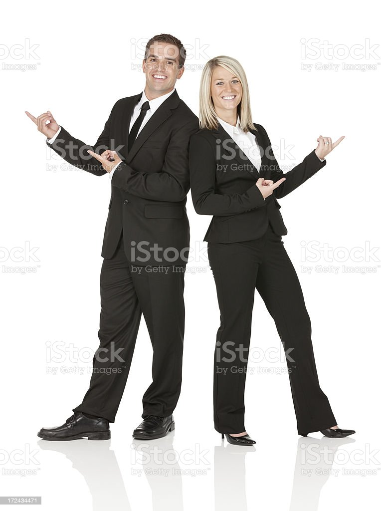 Smiling business executives gesturing royalty-free stock photo