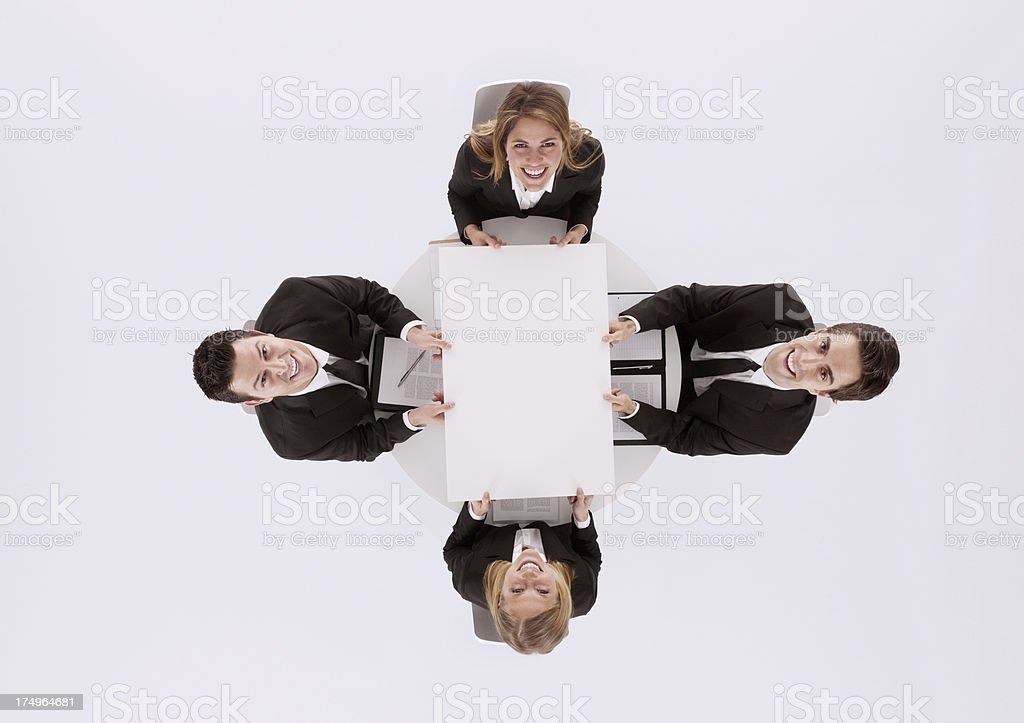 Smiling business executives in a meeting royalty-free stock photo