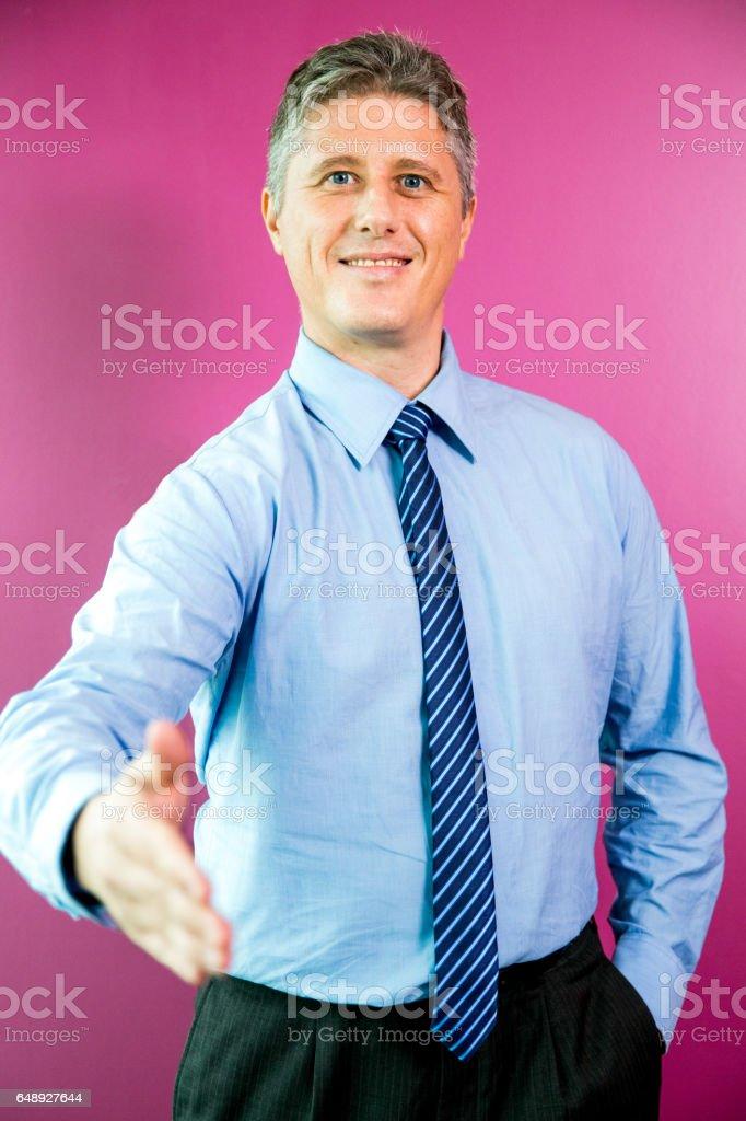Smiling Business Man Extending Arm for Handshake stock photo