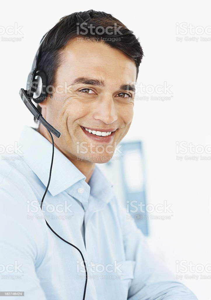 Smiling business man using a headset at work royalty-free stock photo
