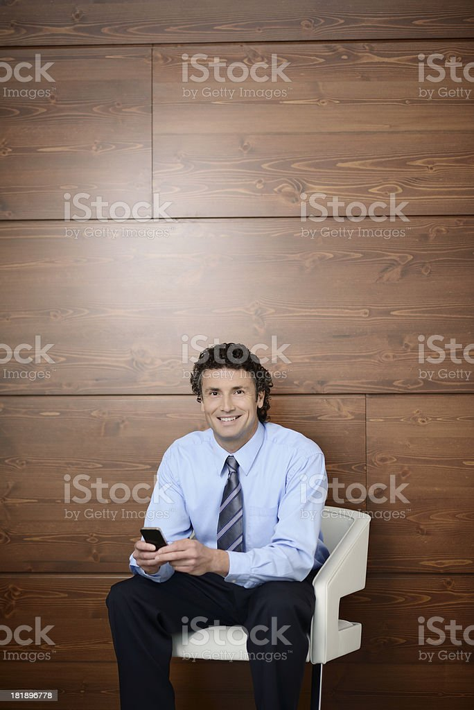Smiling business man using cell phone royalty-free stock photo