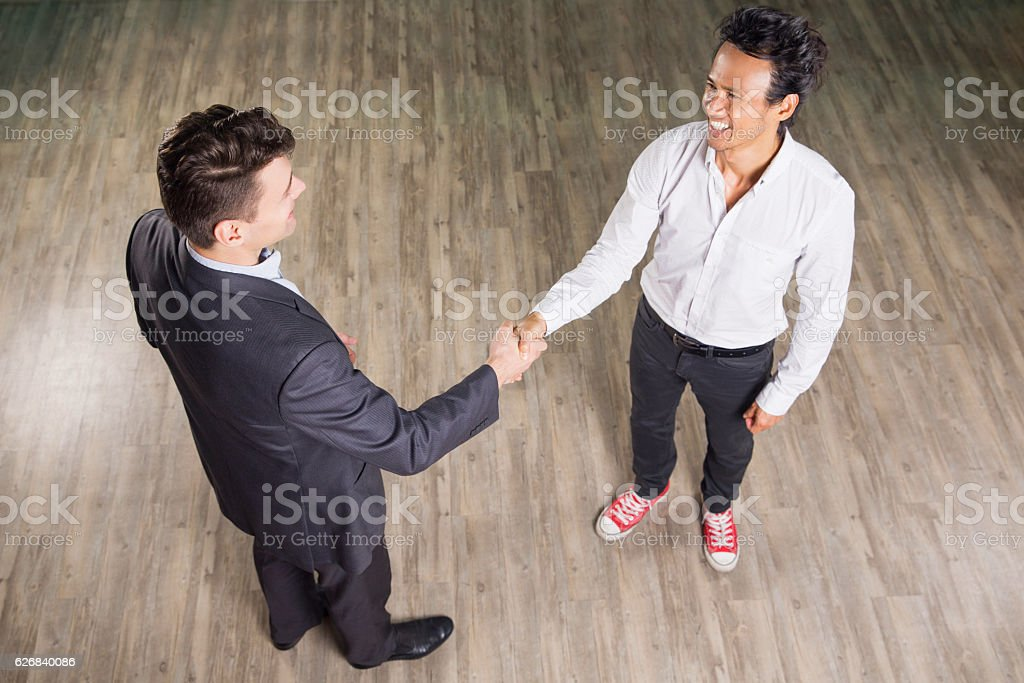 Smiling Business Men Meeting and Shaking Hands stock photo
