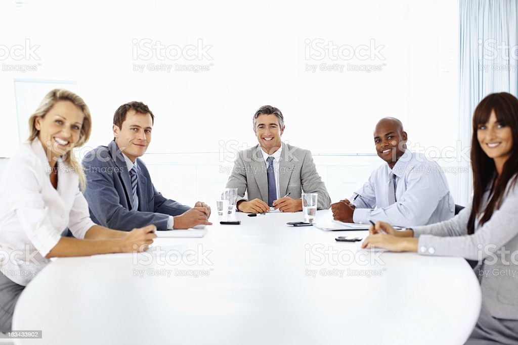 Smiling business people at meeting table royalty-free stock photo