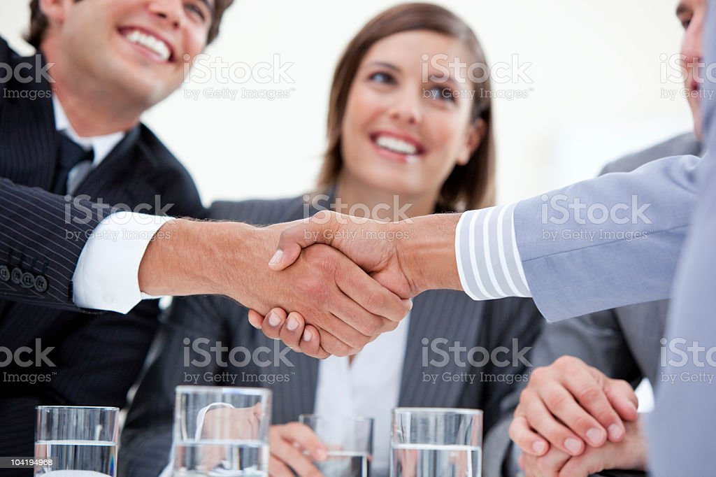 Smiling business people closing a deal royalty-free stock photo