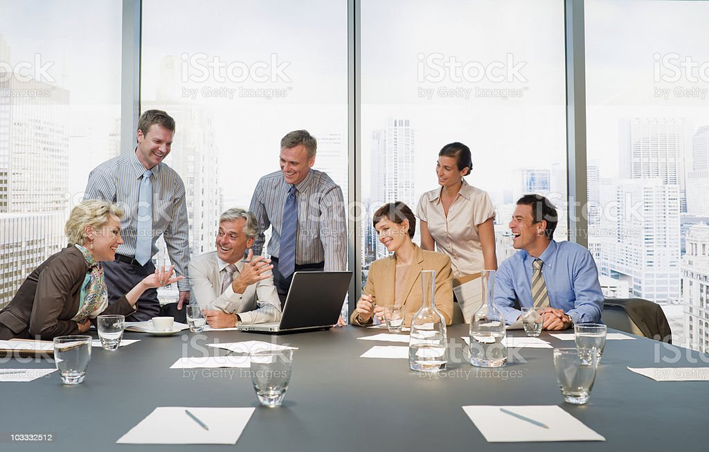 Smiling business people having a meeting in conference room...