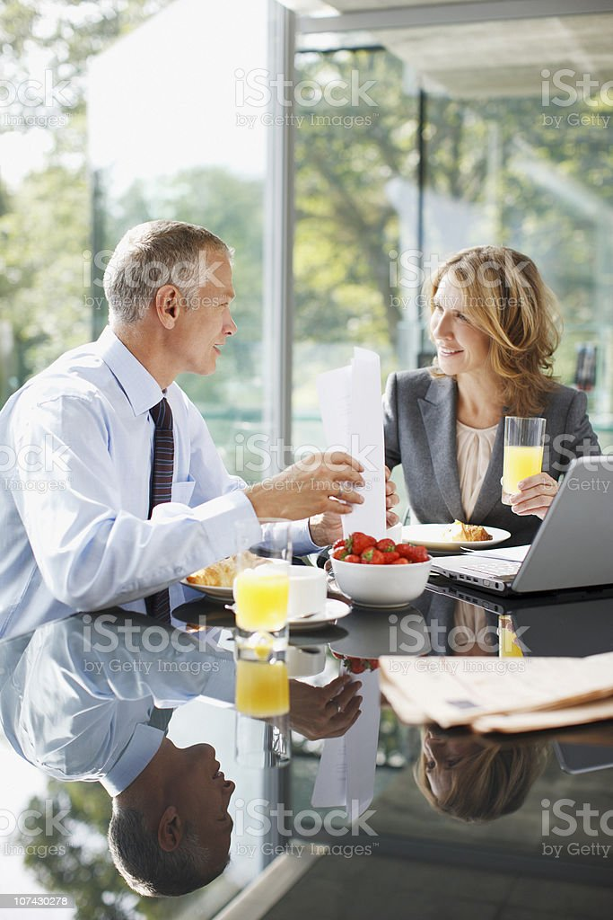Smiling business people having breakfast royalty-free stock photo