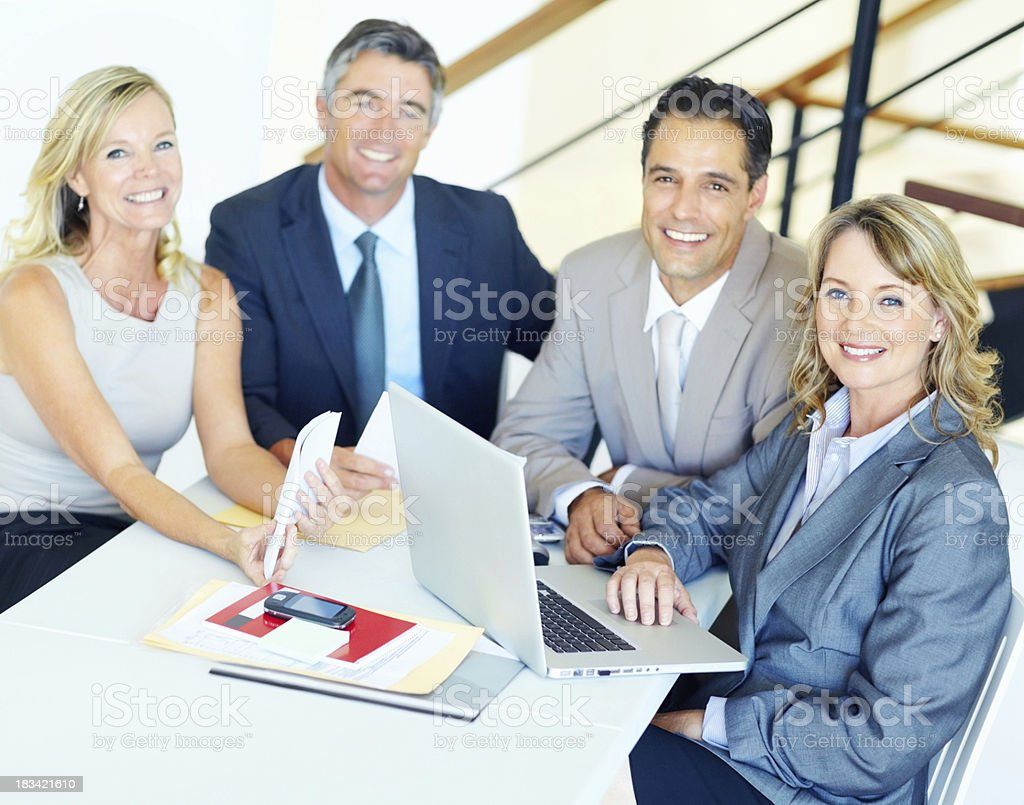 Smiling business people in a meeting royalty-free stock photo