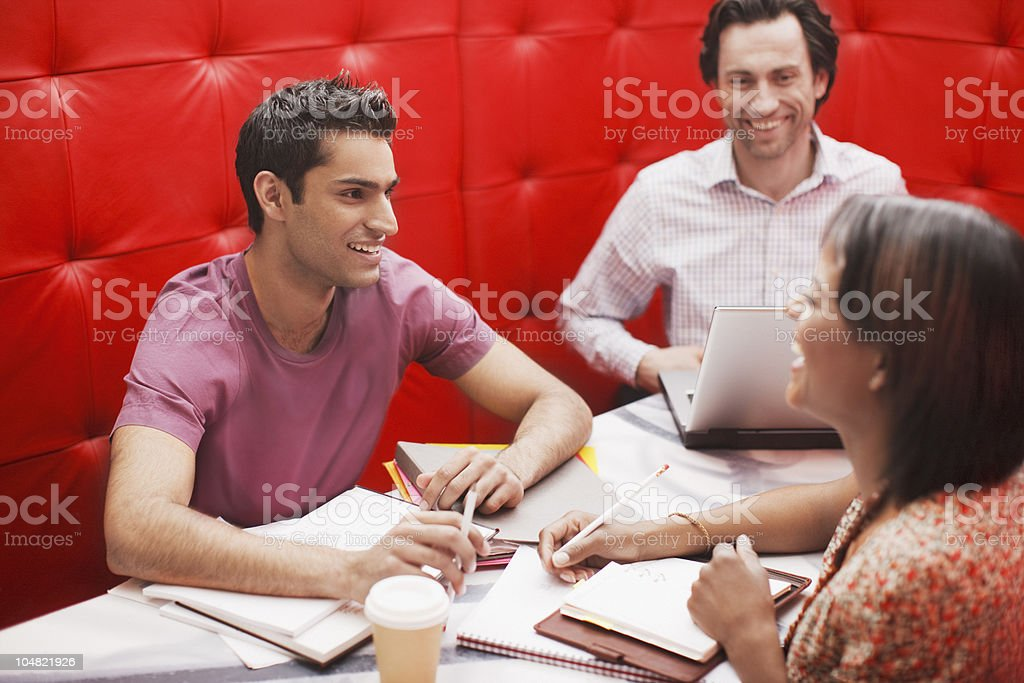 Smiling business people in meeting royalty-free stock photo
