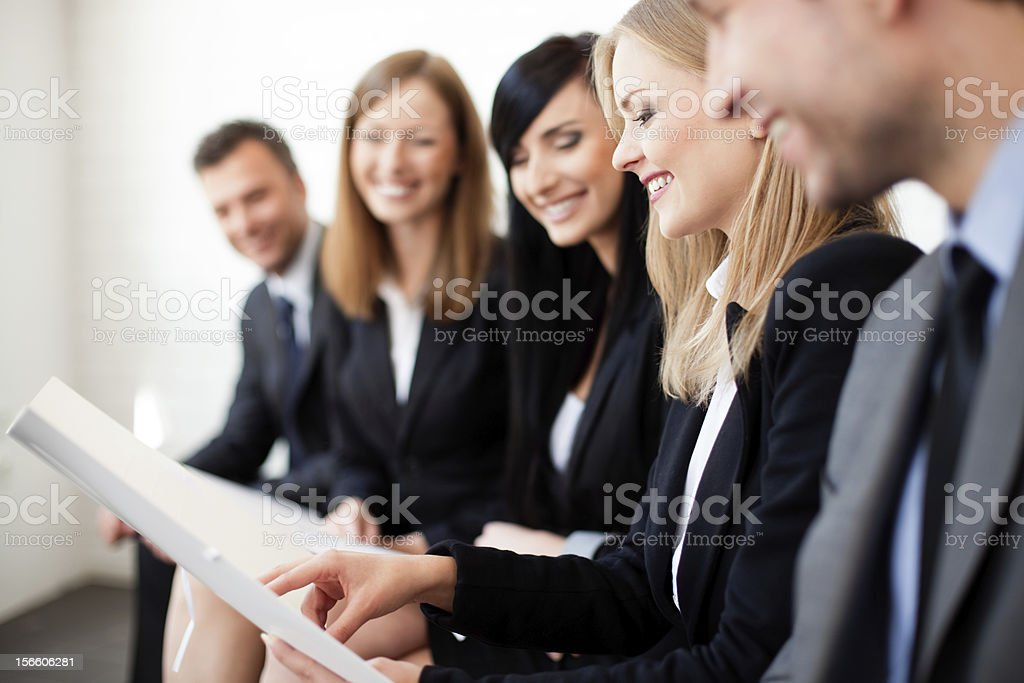 Smiling business people looking at same document royalty-free stock photo