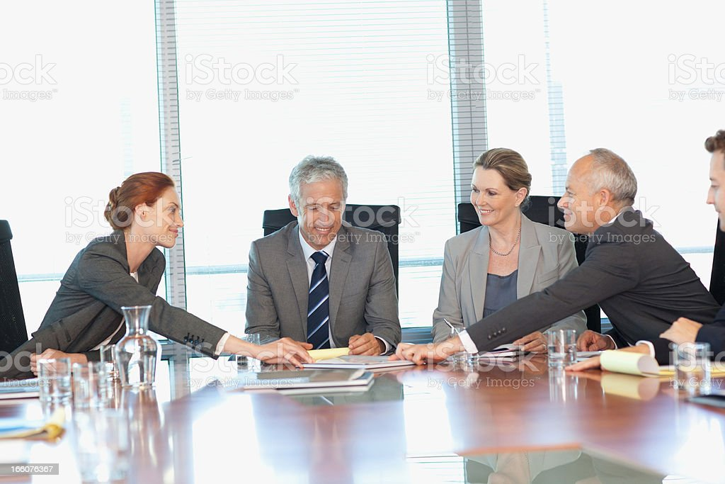 Smiling business people meeting at table in conference room royalty-free stock photo