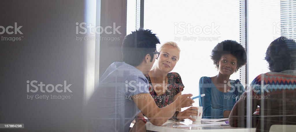 Smiling business people meeting in conference room stock photo