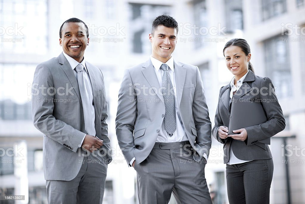 Smiling business people standing outside. royalty-free stock photo