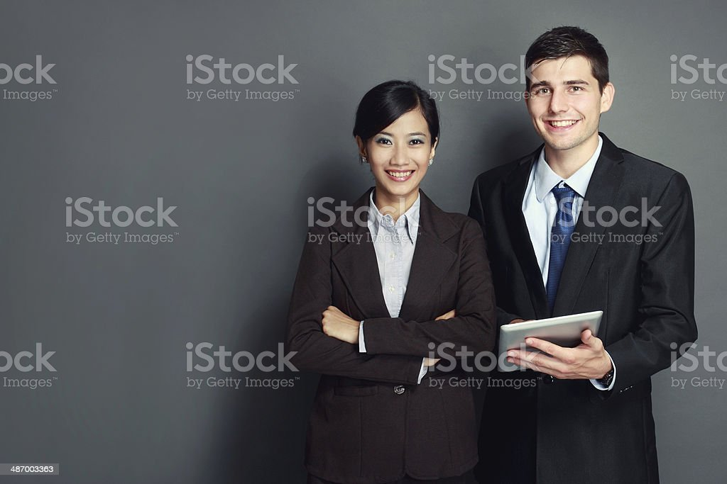 smiling business team with tablet pc stock photo
