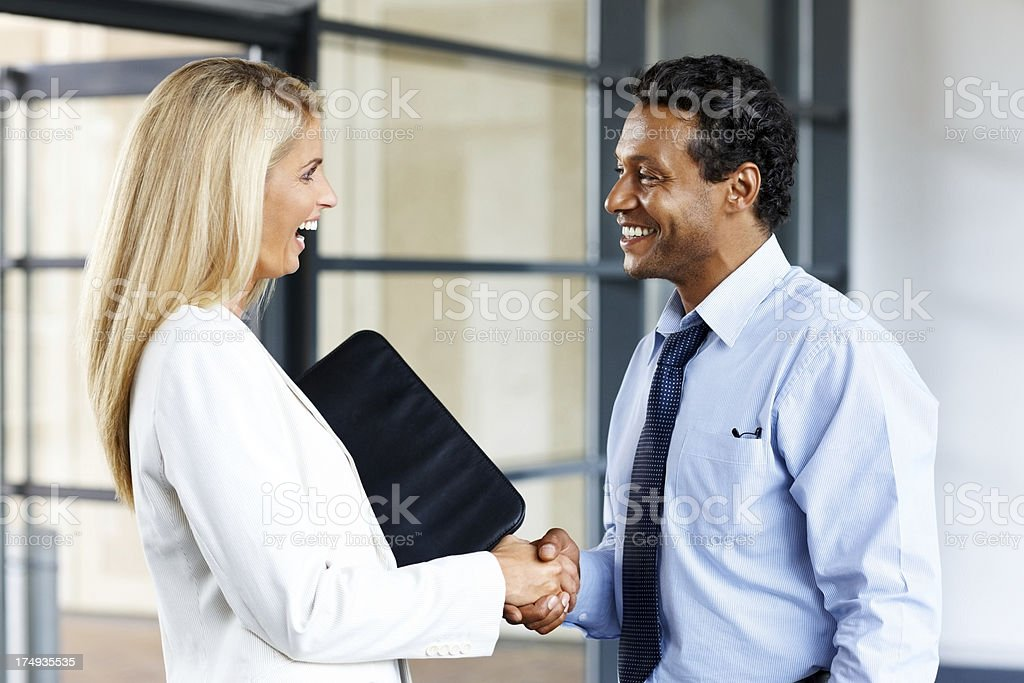 Smiling business woman appreciating her colleague royalty-free stock photo
