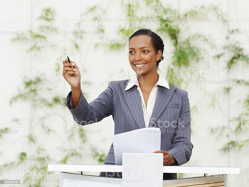 Smiling business woman during seminar royalty-free stock photo