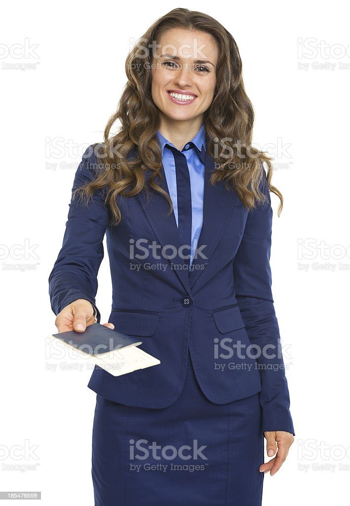 Smiling business woman giving passport with air tickets royalty-free stock photo