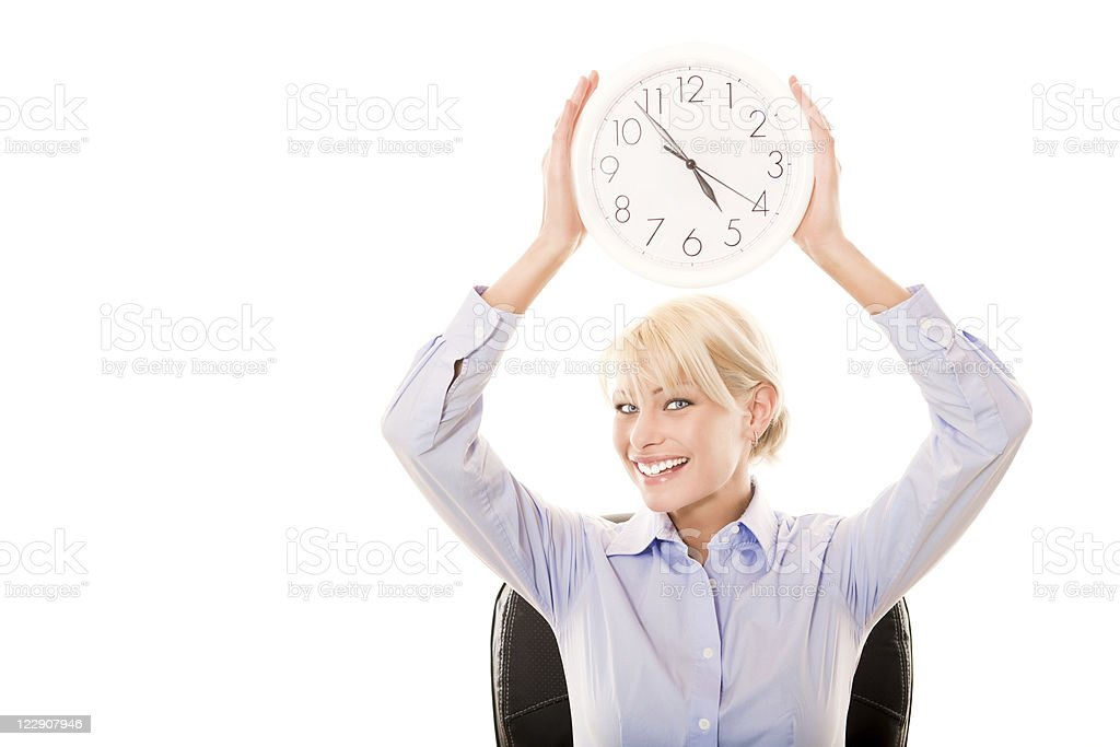 Smiling business woman holding a clock royalty-free stock photo