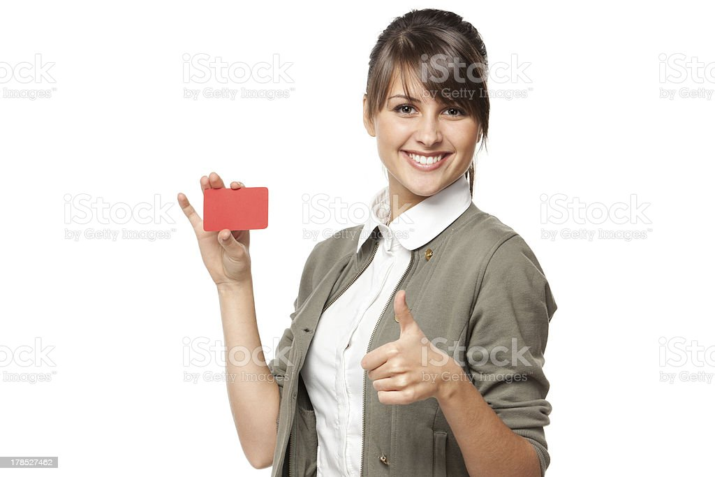 Smiling business woman holding empty credit card stock photo