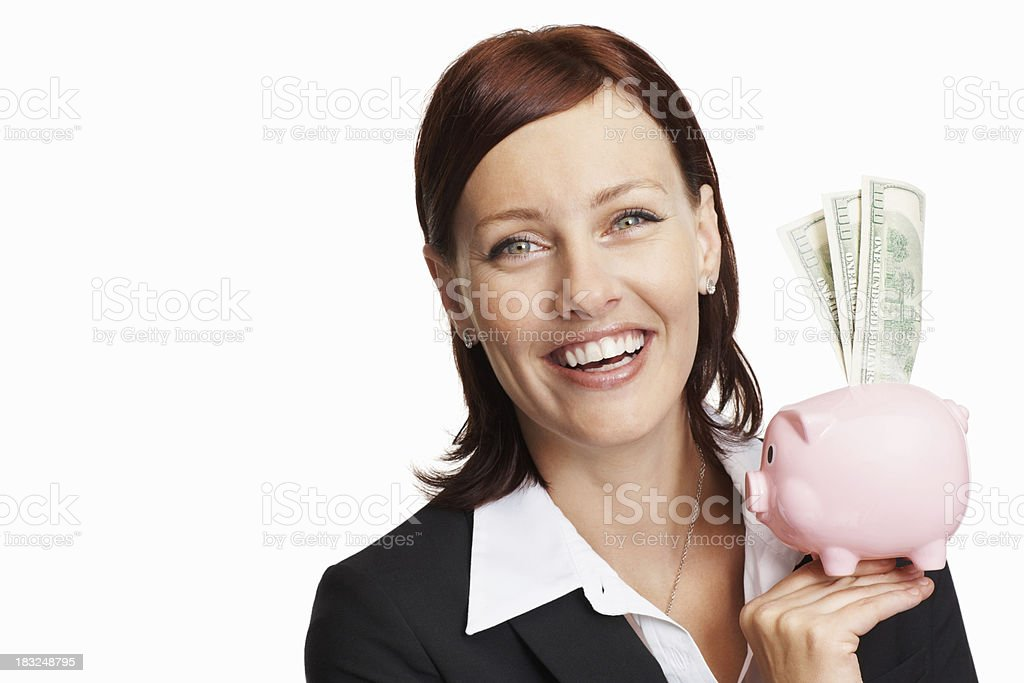 Smiling business woman holding piggy bank royalty-free stock photo