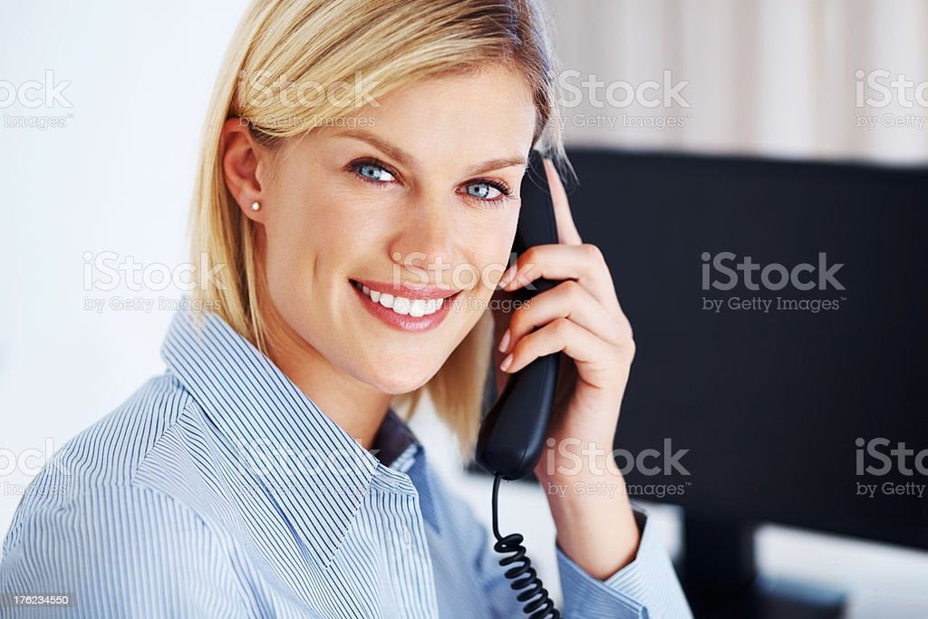 Smiling business woman on call stock photo