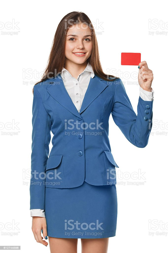 Smiling business woman showing blank credit card in blue suit stock photo