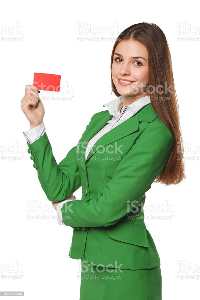 Smiling business woman showing blank credit card in green suit stock photo