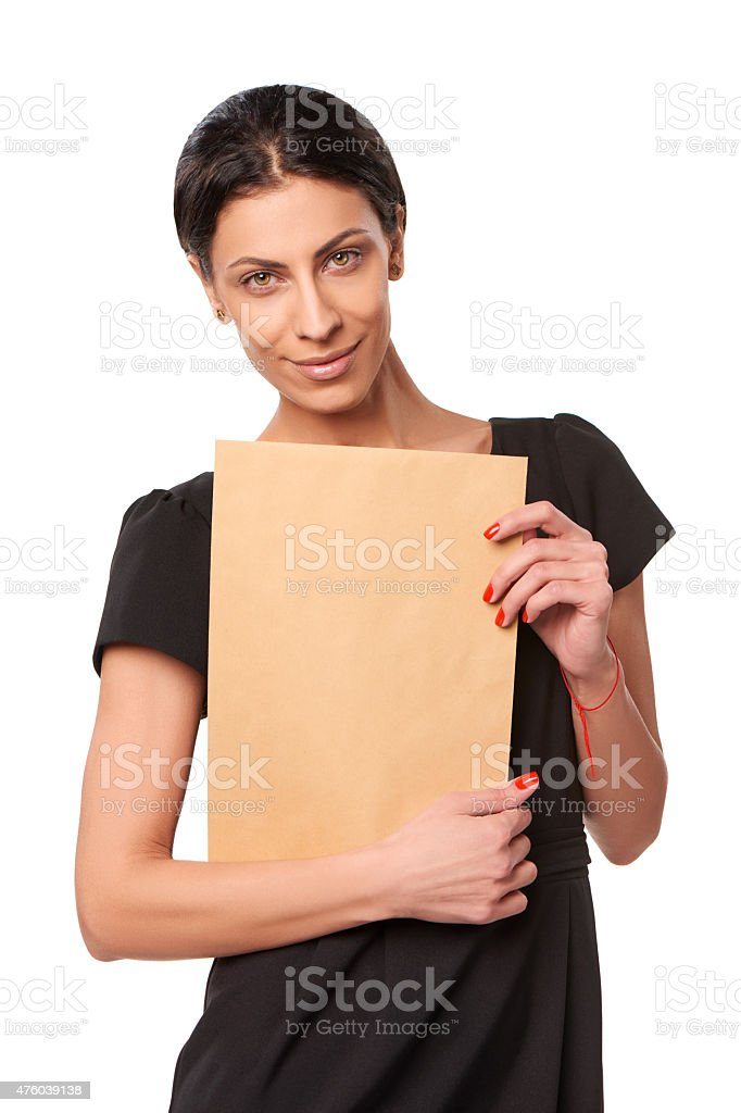 Smiling business woman showing envelope stock photo