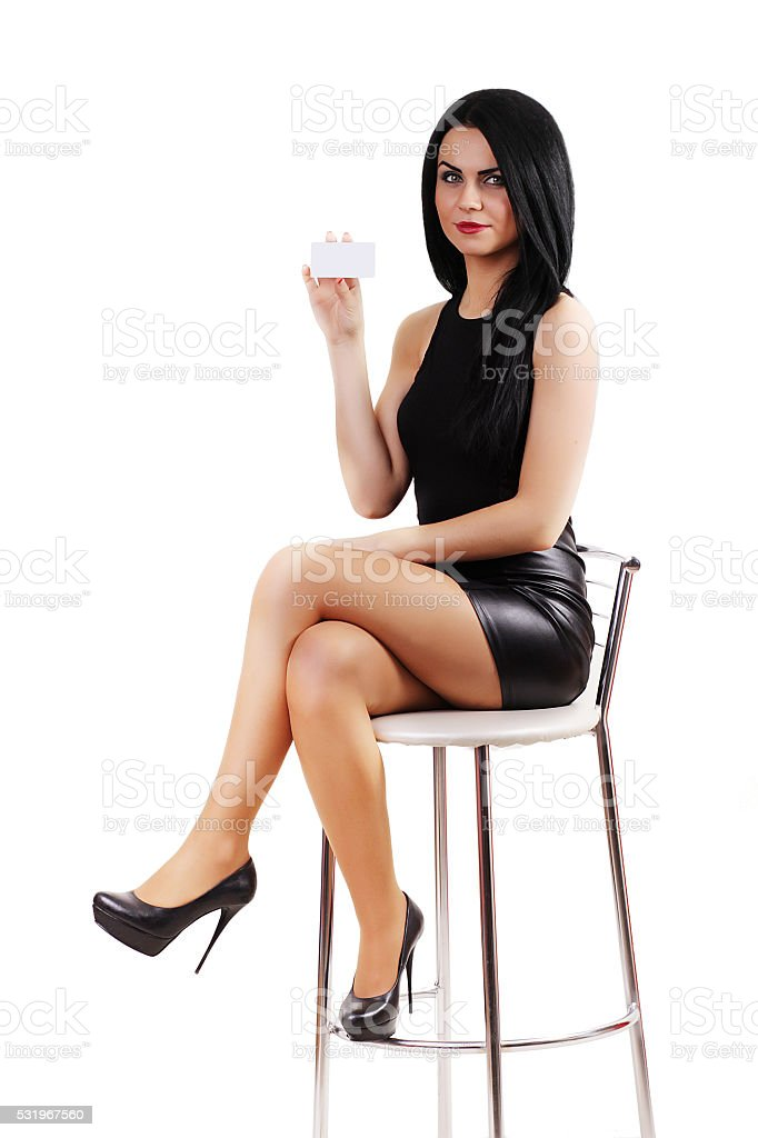 Smiling business woman sitting in a chair. Young businessman smi royalty-free stock photo