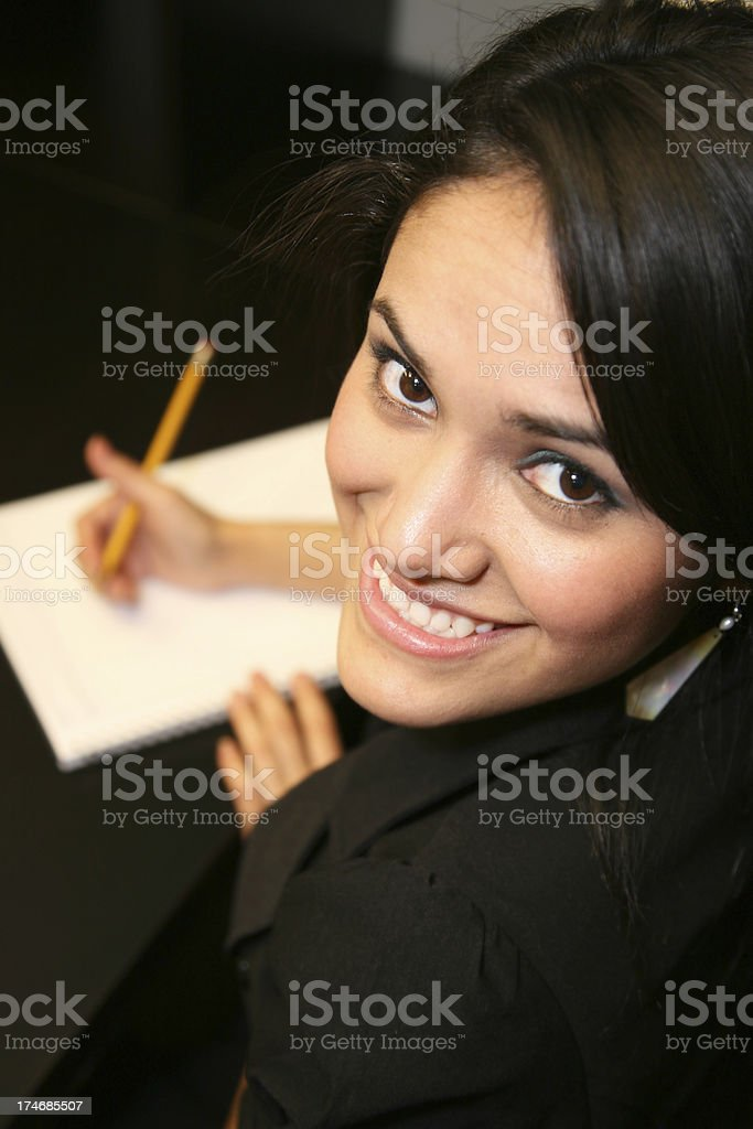 Smiling Business Woman Taking Notes royalty-free stock photo
