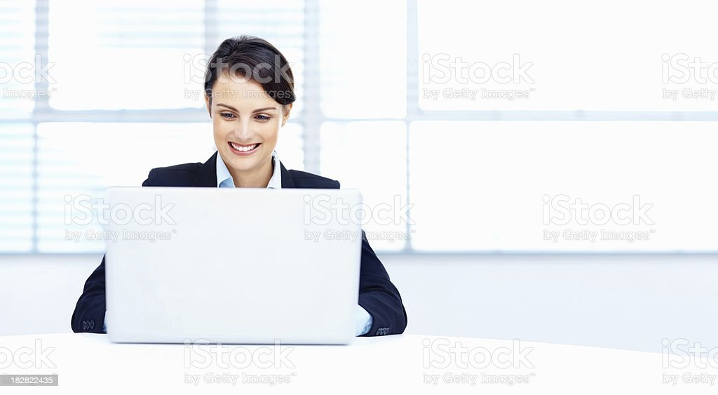 Smiling business woman using a laptop royalty-free stock photo