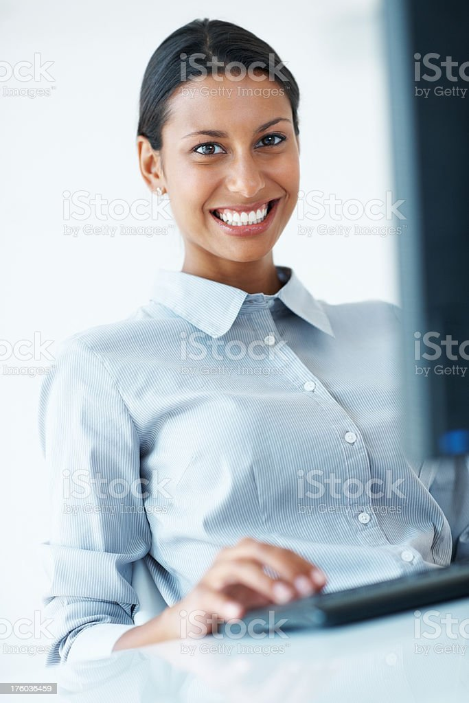 Smiling business woman using computer stock photo