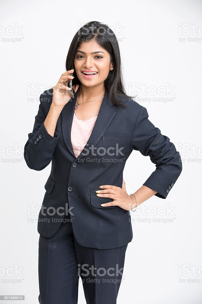 Smiling business woman using phone stock photo