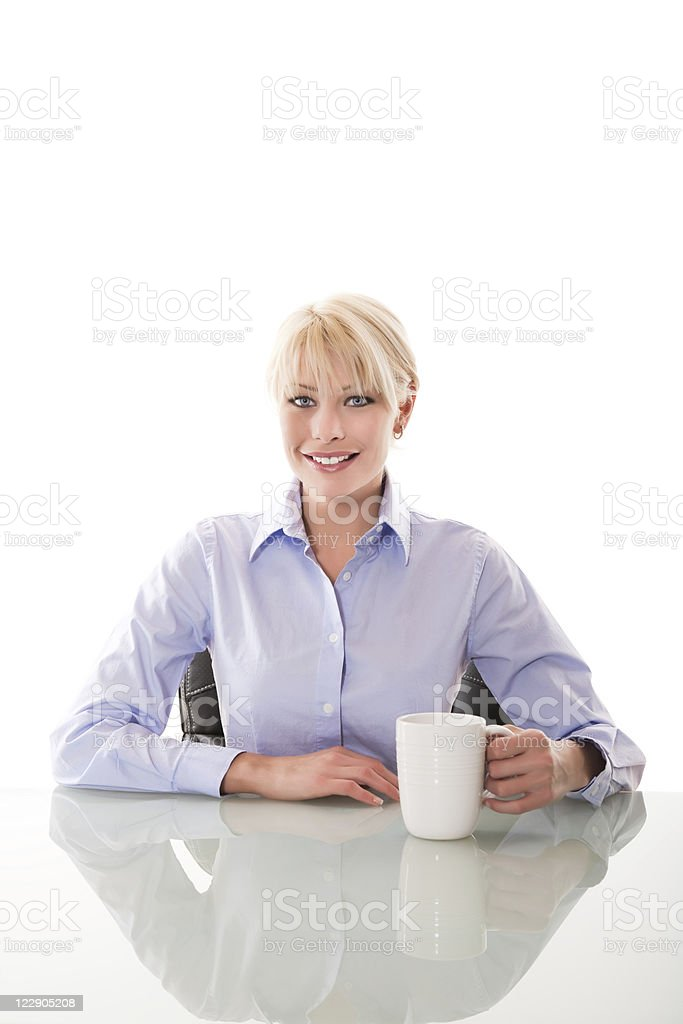 Smiling business woman with a coffee cup royalty-free stock photo